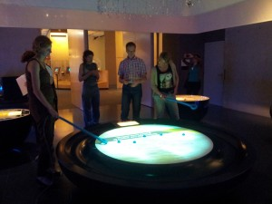 Photo of people trying out interactive displays at Museon